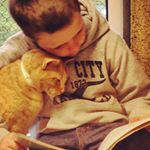 Images of Kids Reading to Shelter Cats Will Melt Your Heart